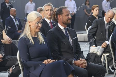 Crown Prince Haakon Magnus (C) and Crown Princess Mette-Marit (L) during the memorial service in the Government Quarter in Oslo, Norway, 22 July 2021, 10 years after the terrorist attack on 22 July 2011. Norway is commemorating the event that killed 77 people at the Government Office Complex in Oslo and on the island of Utoya. National memorial events will be held throughout the day in Oslo and in the municipality of Hole.