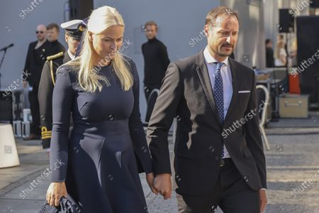 Stock Photo of Crown Prince Haakon Magnus (R) and Crown Princess Mette-Marit (L) attend the memorial service in Oslo, Norway, 22 July 2021, commemorating the 10 years aniversary after the terrorist attack on 22 July 2011. Norway is commemorating the event that killed 77 people at the Government Office Complex in Oslo and on the island of Utoya. National memorial events will be held throughout the day in Oslo and in the municipality of Hole.