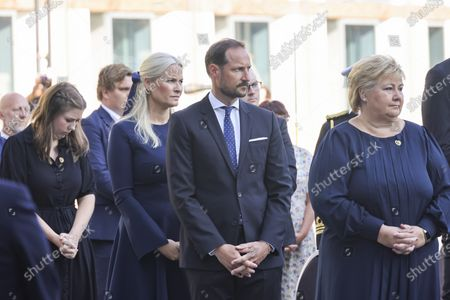 Crown Prince Haakon Magnus (C), Crown Princess Mette-Marit (C-L) and Prime Minister Erna Solberg (R) attend the memorial service at the Government Office Complex, in Oslo, Norway, 10 years after the terrorist attack on 22 July 2011. Norway is commemorating the event that killed 77 people at the Government Office Complex in Oslo and on the island of Utoya. National memorial events will be held throughout the day in Oslo and in the municipality of Hole.
