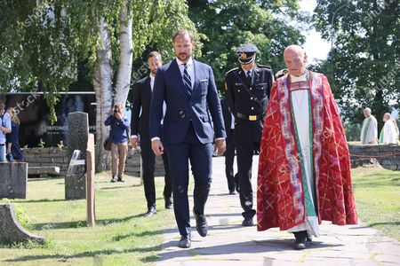 Norway's Crown Prince Haakon (L) and Bishop Jan Otto Myrseth attend the memorial service at Hole Church for the victims of the 2011 terrorist attacks, outside Oslo, Norway, 22 July 2021. Norway is commemorating the event that killed 77 people at the Government Office Complex in Oslo and on the island of Utoya. National memorial events will be held throughout the day in Oslo and in the municipality of Hole.
