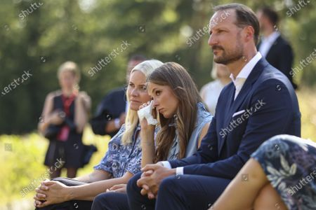 Stock Image of (L-R) Norway's Crown Princess Mette-Marit, Princess Ingrid Alexandra and Crown Prince Haakon attend a memorial service for the victims of the 2011 terrorist attacks, on Utoya, outside Oslo, Norway, 22 July 2021. Norway is commemorating the event that killed 77 people at the Government Office Complex in Oslo and on the island of Utoya. National memorial events will be held throughout the day in Oslo and in the municipality of Hole.