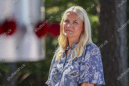 Norway's Crown Princess Mette-Marit attends a memorial service for the victims of the 2011 terrorist attacks, on Utoya, outside Oslo, Norway, 22 July 2021. Norway is commemorating the event that killed 77 people at the Government Office Complex in Oslo and on the island of Utoya. National memorial events will be held throughout the day in Oslo and in the municipality of Hole.
