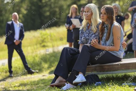 Norway's Crown Princess Mette-Marit (2-L) and Princess Ingrid Alexandra (R) attend a memorial service for the victims of the 2011 terrorist attacks, on Utoya, outside Oslo, Norway, 22 July 2021. Norway is commemorating the event that killed 77 people at the Government Office Complex in Oslo and on the island of Utoya. National memorial events will be held throughout the day in Oslo and in the municipality of Hole.