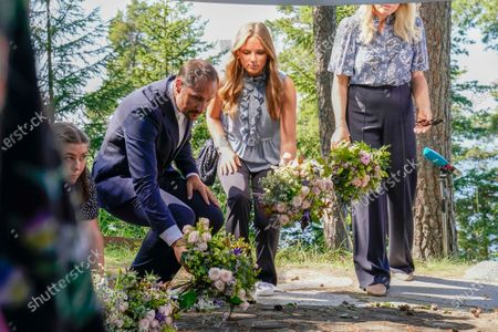 Stock Picture of Norway's Crown Prince Haakon and Princess Ingrid Alexandra lay flowers at the July 22 memorial during a memorial service for the victims of the 2011 terrorist attacks, on Utoya, outside Oslo, Norway, 22 July 2021. Norway is commemorating the event that killed 77 people at the Government Office Complex in Oslo and on the island of Utoya. National memorial events will be held throughout the day in Oslo and in the municipality of Hole.