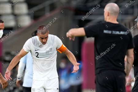 Stock Image of New Zealand's Winston Reid walks on the sidelines injured during a men's soccer match against South Korea at the 2020 Summer Olympics, in Kashima, Japan