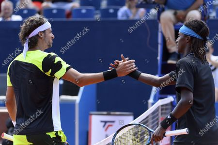 Feliciano Lopez of Spain (L) congratulates Mikael Ymer of Sweden (R) on his victory after their round of 16 match at the Swiss Open tennis tournament in Gstaad, Switzerland, 22 July 2021.