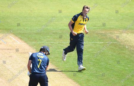 Stock Image of Michael Hogan of Glamorgan celebrates the wicket of Matthew Lamb.