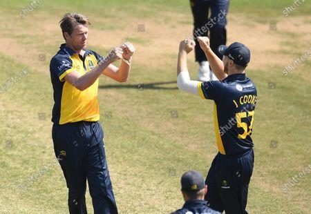 Michael Hogan of Glamorgan celebrates the wicket of Matthew Lamb.