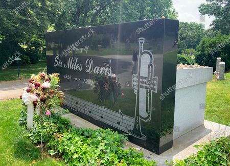 """The grave of jazz great Miles Davis appears at Woodlawn Cemetery in the Bronx borough of New York on . The corner is a stop on a trolley tour of """"jazz and vaudeville greats"""" offered by the cemetery"""