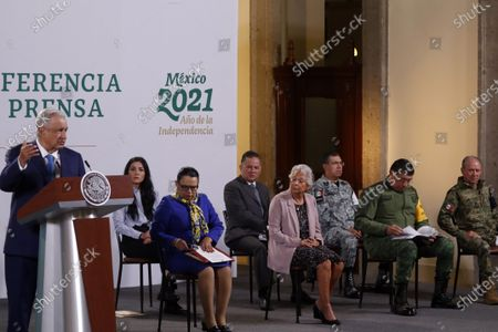Stock Photo of Mexico's President Andres Manuel Lopez Obrador accompanied by Mexico's Minister of Security Rosa Icela Rodriguez, Minister of the Interior Olga Sanchez Cordero, Director of Mexico's National Guard Luis Rodriguez Bucio, Mexico's Secretary of National Defense Luis Crescencio Sandoval, Mexico's Secretary of the Navy Rafael Ojeda Duran, during daily briefing conference at National Palace on July 21, 2021 in Mexico City, Mexico.