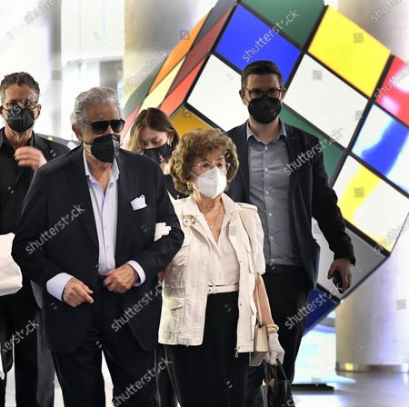 Wearing face masks because of the coronavirus disease (COVID-19) pandemic, Spanish tenor and conductor Placido Domingo (L) arrives with his wife Marta Domingo for a press conference introducing members of the international jury of the Hungarian classical musical television talent show Virtuosos V4+ Croatia at the headquarters of the Media Services and Support Trust Fund in Budapest, Hungary, 22 July 2021.