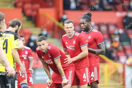Stock Picture of Aberdeen's Calvin Ramsay (22), Aberdeen's Andrew Considine (4) and Aberdeen's Jay Emmanuel-Thomas (14) line up for a corner during the Europa Conference League match between Aberdeen and BK Hacken at Pittodrie Stadium, Aberdeen