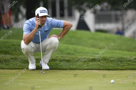 Michael Thompson lines up a shot on the seventh hole during the first round of the 3M Open golf tournament in Blaine, Minn