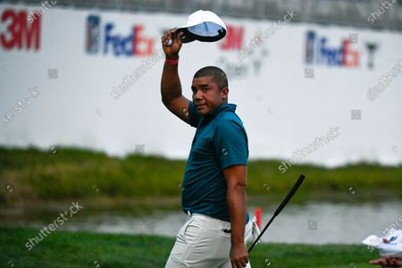 Jhonattan Vegas acknowledges the crowd after making a birdie on the 18th hole and tying for the lead during the first round of the 3M Open golf tournament in Blaine, Minn