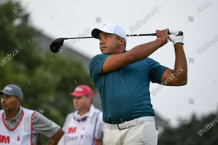 Jhonattan Vegas watches his tee shot on the 18th hole during the first round of the 3M Open golf tournament in Blaine, Minn
