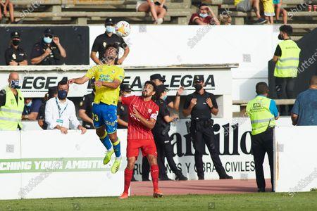 Stock Photo of Isaac Hernandez of Las Palmas and Jesus Navas of Sevilla during friendly match between Sevilla Futbol Club and Union Deportiva Las Palmas at Municipal La Linea Stadium on July 22, 2021 in Cadiz, Spain.