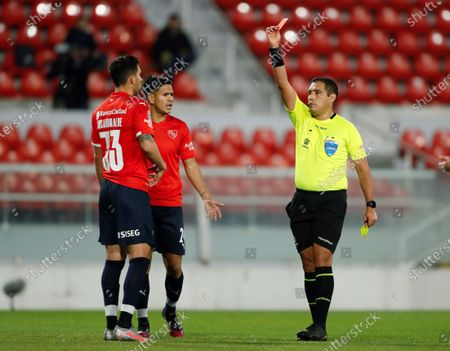 Stock Image of Juan Manuel Insarrualde (L) of Independiente receives a red card by the referee Diego Haro during the Copa Sudamericana soccer match between Independiente and Santos at Libertadores de America Stadium in Avellaneda, Argentina, 22 July 2021.