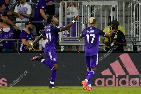 Orlando City midfielder Andres Perea, left, celebrates his goal against the Philadelphia Union with teammate forward Nani (17) who made an assist during the second half of an MLS soccer match, in Orlando, Fla