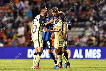 Miguel Layun (L) and Bruno Valdez (R) of Club America react during the opening 2021 Liga MX soccer match between Queretaro and Club America at the La Corregidora Stadium, in Queretaro, Mexico, 22 July 2021.