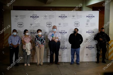(L-R) former public officials Hugo Flores, Erlina Handal, Violeta Menjivar, Carlos Caceres and Calixto Mejia pose for photographers after being arrested today, at the Central Investigation Division of the police in San Salvador, El Salvador, 22 July 2021. The Prosecutor's Office of El Salvador issued an arrest warrant against ex-president Salvador Sanchez Ceren (2014-2019) for his alleged participation in the embezzlement of 351 million US dollar when he was vice president of the Government of his predecessor, Mauricio Funes, the prosecutor reported this Thursday.