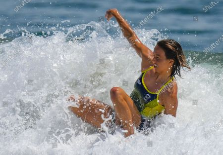 Sally Fitzgibbons from Australia rotates her board through the white water as she surfs during a training session at the Tsurigasaki Surfing Beach, Ichinomiya, Japan 23 July 2021. Surfing will debut as an Olympic sport for the first time in history when competition begins on 25 July 2021.