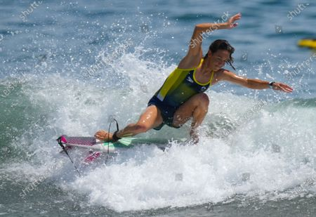 Sally Fitzgibbons from Australia surfs during a training session at the Tsurigasaki Surfing Beach, Ichinomiya, Japan 23 July 2021. Surfing will debut as an Olympic sport for the first time in history when competition begins on 25 July 2021.