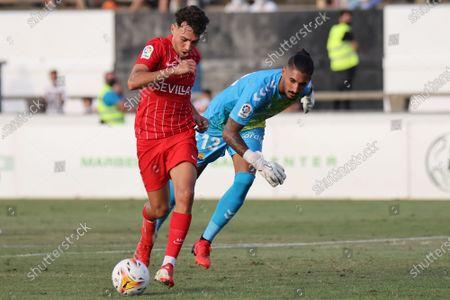 Stock Image of Munir El Haddadi of Sevilla CF and Alvaro Valles of Las Palmas UD during the preseason friendly match between Sevilla FC and UD Las Palmas at La Linea Stadium in La Linea, Spain.