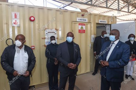 Stock Image of (210722) - KWENENENG DISTRICT (BOTSWANA), July 22, 2021 (Xinhua) - Botswana President Mokgweetsi Masisi (R, front) visits to vaccinating and testing center in Kweneng District, Botswana, on July 22, 2021. Botswana's President, Mokgweetsi Masisi on Thursday urged citizens to get COVID-19 vaccines when their turn came, stating that all of the vaccines had been tested and approved by the appropriate authorities.