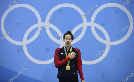 United States' Maya DiRado celebrates with her gold medal during the women's 200-meter backstroke medals ceremony during the swimming competitions at the 2016 Summer Olympics in Rio de Janeiro, Brazil. A debate is fomenting between former gold medalist DiRado and some American swimmers over Michael Andrew's decision not to be vaccinated against the COVID-19 virus on the eve of competition at the Tokyo Olympics