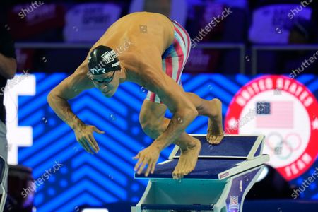 Michael Andrew participates in the men's 50 freestyle during wave 2 of the U.S. Olympic Swim Trials in Omaha, Neb. A debate is fomenting between former gold medalist Maya DiRado and some American swimmers over Andrew's decision not to be vaccinated against the COVID-19 virus on the eve of competition at the Tokyo Olympics