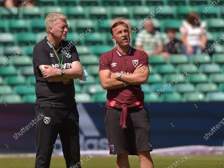 David Moyes (L) and Mark Noble of West Ham United take in the surroundings of Celtic Park