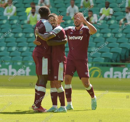 Manuel Lanzini and Pablo Fornals of West Ham United  celebrate with Michail Antonio after he scores his second goal