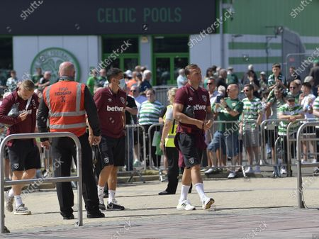 Stock Image of Mark Noble (R) of West Ham United arriving at Celtic Park