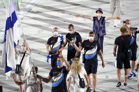 Flag bearers trap shooter Satu Mäkelä-Nummela and swimmer Ari-Pekka Liukkonen of Finland, Mika Lehtimäki director of the Finnish Olympic Committee's high-level sports unit and delegation of Team Finland parade during the opening ceremony of the Tokyo Summer Olympic Games at the Tokyo Olympic Stadium on July 23, 2021.