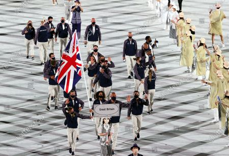 Flag Bearers of Great Britain Hannah Mills and Mohamed Sbihi enter the stadium during the Opening Ceremony of the Tokyo 2020 Olympic Games at the Olympic Stadium in Tokyo, Japan, 23 July 2021.