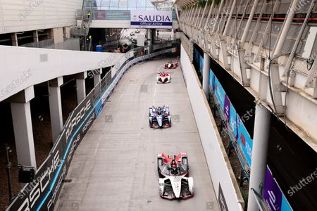 Stock Photo of Pascal Wehrlein of Germany driving for (99) TAG Heuer Porsche is in front of Robin Frijns of France driving for (4) Envision Virgin in race 2; Excel Circuit, Docklands, London, England; Formula E London E Prix.