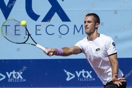 Laslo Djere of Serbia in action during the quarterfinal match against Arthur Rinderknech of France at the Swiss Open tennis tournament in Gstaad, Switzerland, 23 July 2021.