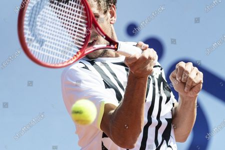 Stock Photo of Vit Kopriva of Czech Republic in action against Mikael Ymer of Sweden during the quarterfinal match against Mikael Ymer of Sweden at the Swiss Open tennis tournament in Gstaad, Switzerland, 23 July 2021.