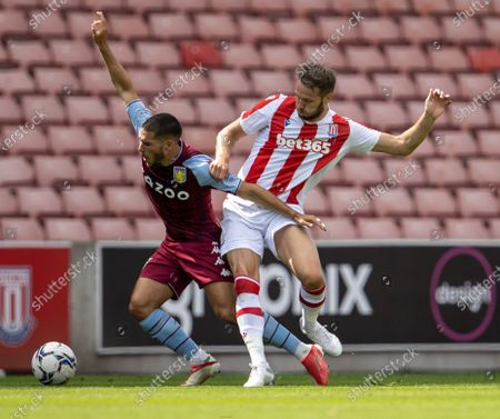 Nick Powell of Stoke City tackles John McGinn of Aston Villa; Bet365 Stadium, Stoke, Staffordshire, England; Pre Season Friendly Football, Stoke City versus Aston Villa.