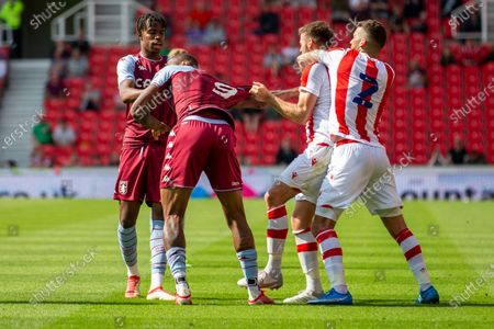 Nick Powell of Stoke City reacts after being softly headbutted by Wesley of Aston Villa who received a red card for the action; Bet365 Stadium, Stoke, Staffordshire, England; Pre Season Friendly Football, Stoke City versus Aston Villa.