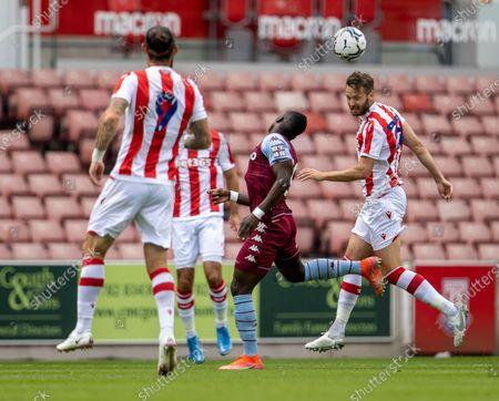 Nick Powell of Stoke City heads the ball towards Steven Fletcher; Bet365 Stadium, Stoke, Staffordshire, England; Pre Season Friendly Football, Stoke City versus Aston Villa.