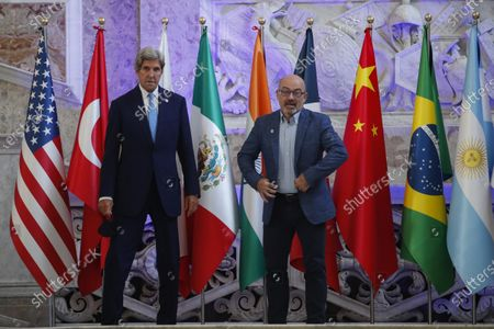 Special Presidential Envoy for Climate John Kerry and Italian Minister for Ecological Transition Roberto Cingolani pose during a photo opportunity at Palazzo Reale in Naples, Italy, where a G20 meeting on environment, climate and energy is under way