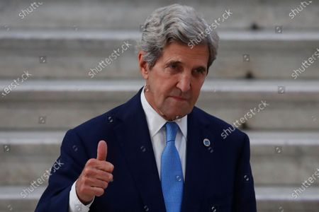 Special Presidential Envoy for Climate John Kerry gestures as he poses during a photo opportunity with Italian Minister for Ecological Transition Roberto Cingolani, at Palazzo Reale in Naples, Italy, where a G20 meeting on environment, climate and energy is under way