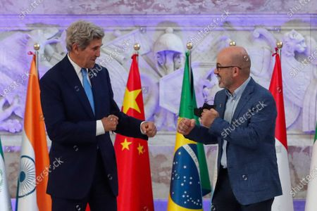 Stock Photo of Special Presidential Envoy for Climate John Kerry and Italian Minister for Ecological Transition Roberto Cingolani pose during a photo opportunity at Palazzo Reale in Naples, Italy, where a G20 meeting on environment, climate and energy is under way