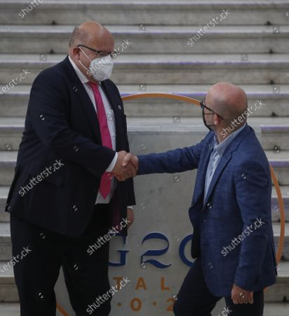 Germany's Federal Minister for Economic Affairs and Energy Peter Altmaier is welcomed by Italian Minister for Ecological Transition Roberto Cingolani as he arrives at Palazzo Reale in Naples, Italy, to take part in a G20 meeting on environment, climate and energy