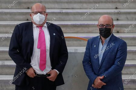 Germany's Federal Minister for Economic Affairs and Energy Peter Altmaier poses with Italian Minister for Ecological Transition Roberto Cingolani as he arrives at Palazzo Reale in Naples, Italy, to take part in a G20 meeting on environment, climate and energy