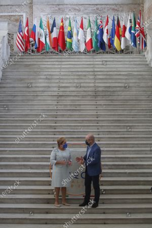 Executive secretary of the United Nations Framework Convention on Climate Change Patricia Espinosa is welcomed by Italian Minister for Ecological Transition Roberto Cingolani as he arrives at Palazzo Reale in Naples, Italy, to take part in a G20 meeting on environment, climate and energy