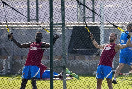 FC Barcelona players Samuel Umtiti (L) and Miralem Pjanic (R) attend a pre-season training session held at club's Sport City in Sant Joan Despi, Barcelona, Spain, 23 July 2021.