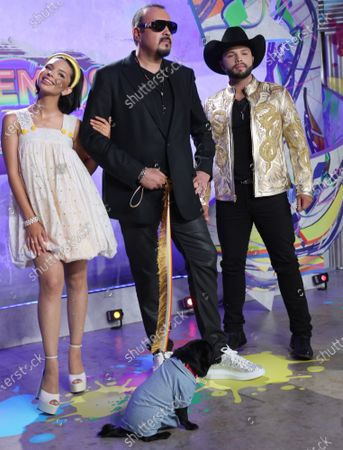 Stock Photo of (L-R) Ángela Aguilar, Pepe Aguilar and Leonardo Aguilar arrive at the 2021 Univision's Premios Juventud awards show at the University of Miami, Watsco Center,, Miami, Florida on Thursday,  July 22, 2021.