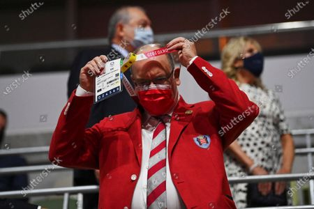 Prince Albert II of Monaco adjusts his ID as he arrives during the opening ceremony in the Olympic Stadium at the 2020 Summer Olympics, in Tokyo, Japan
